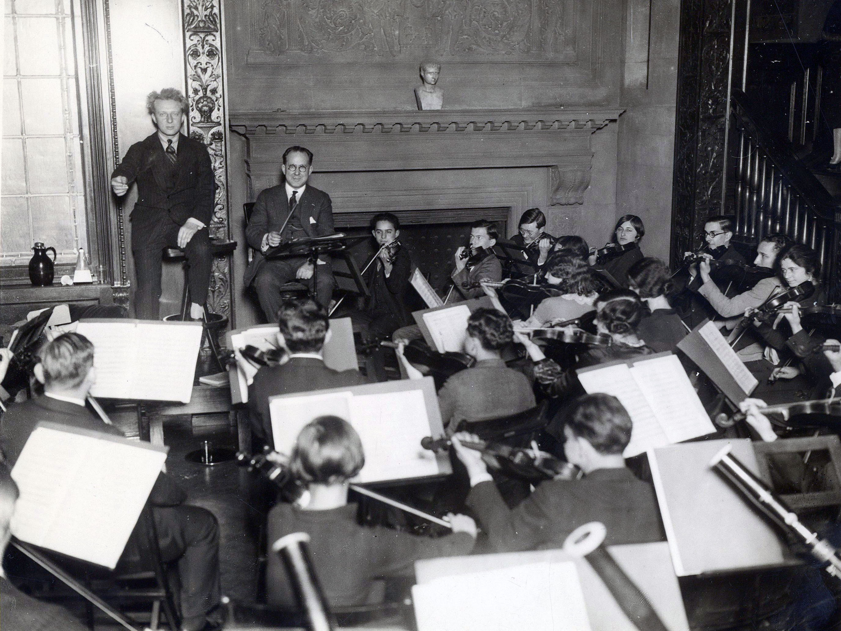 Leopold Stokowski rehearses Curtis students in the Common Room, 1925